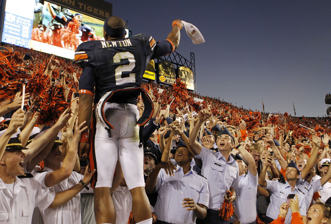 AUBURN, AL - OCTOBER 16:  Quarterback Cam Newton #2 of the Auburn Tigers celebrates with the crowd after the game against the Arkansas Razorbacks at Jordan-Hare Stadium on October 16, 2010 in Auburn, Alabama.  The Tigers beat the Razorbacks 65-43.  (Photo