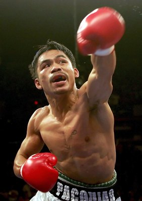 LAS VEGAS - NOVEMBER 18:  Manny Pacquiao of the Philippines throws a punch against Erik Morales during their super featherweight bout at the Thomas & Mack Center on November 18, 2006 in Las Vegas, Nevada. Pacquiao knocked out Morales in the third round.