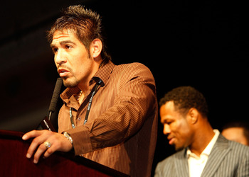 LAS VEGAS - DECEMBER 06:  (L) Antonio Margarito speaks during a news conference as Shane Mosley stands behind him after Manny Pacquiao of the Philippines defeated Oscar De La Hoya during their welterweight fight at the MGM Grand Garden Arena December 6, 2