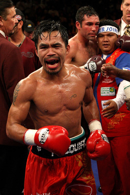 LAS VEGAS - DECEMBER 06:  (L-R) Manny Pacquiao of the Philippines celebrates after defeating Oscar De La Hoya in the eighth round by TKO in their welterweight fight at the MGM Grand Garden Arena December 6, 2008 in Las Vegas, Nevada.  (Photo by Jed Jacobs