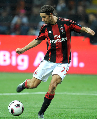 MILAN, ITALY - OCTOBER 16: Luca Antonini of AC Milan in action during the Serie A match between AC Milan and AC Chievo Verona at Stadio Giuseppe Meazza on October 16, 2010 in Milan, Italy.  (Photo by Massimo Cebrelli/Getty Images)
