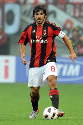 MILAN, ITALY - SEPTEMBER 26:  Gennaro Gattuso of Milan in action during the Serie A match between Milan and Genoa at Stadio Giuseppe Meazza on September 26, 2010 in Milan, Italy.  (Photo by Tullio M. Puglia/Getty Images)