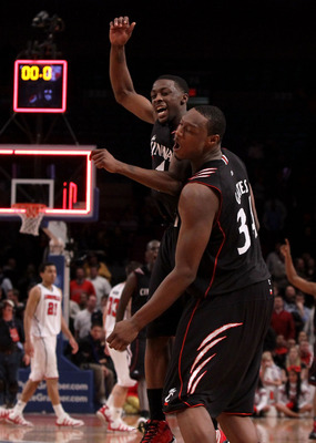 NEW YORK - MARCH 10: Cashmere Wright #1 and Yancy Gates #34 of the Cincinnati Bearcats celebrate after defeating the Louisville Cardinals during the second round of 2010 NCAA Big East Tournament at Madison Square Garden on March 10, 2010 in New York City.