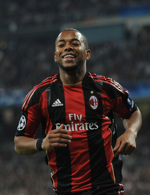 MADRID, SPAIN - OCTOBER 19: Robinho of AC Milan smiles as he goes to take a corner kick during the UEFA Champions League Group G match between Real Madrid and AC Milan at Estadio Santiago Bernabeu on October 19, 2010 in Madrid, Spain.  (Photo by Denis Doy