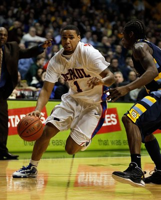 ROSEMONT, IL - JANUARY 20: Mike Stovall #1 of the DePaul Blue Demons moves past Dwight Buycks #23 of the Marquette Golden Eagles at the Allstate Arena on January 20, 2010 in Rosemont, Illinois. DePaul defeated Marquette 51-50. (Photo by Jonathan Daniel/Ge