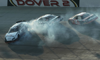 DOVER, DE - SEPTEMBER 25:  Brad Keselowski, driver of the #22 Ruby Tuesday/Discount Tire Dodge, crashes with Kevin Harvick, driver of the #33 Kevin Harvicks Fan Club Chevrolet, and Michael Annett, driver of the #15 Germain.com Toyota, during the NASCAR Na