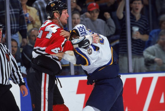 7 Apr 2000: Bob Probert #24 of the Chicago Blackhawks fights with Kelly Chase #39 of the St. Louis Blues at the Kiel Center in St. Louis, Missouri. The Blackhawks defeated the Blues 4-3 in overtime. Mandatory Credit: Elsa Hasch  /Allsport