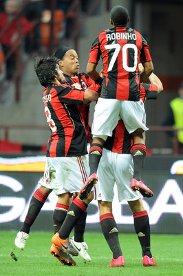 MILAN, ITALY - SEPTEMBER 26:  Players of Milan celebrate the opening goal during the Serie A match between AC Milan and Genoa CFC at Stadio Giuseppe Meazza on September 26, 2010 in Milan, Italy.  (Photo by Tullio M. Puglia/Getty Images)