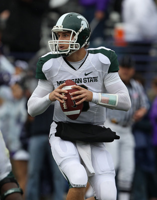 EVANSTON, IL - OCTOBER 23: Kirk Cousins #8 of the Michigan State Spartans rolls out to look for receiver against the Northwestern Wildcats at Ryan Field on October 23, 2010 in Evanston, Illinois. Michigan State defeated Northwestern 35-27. (Photo by Jonat