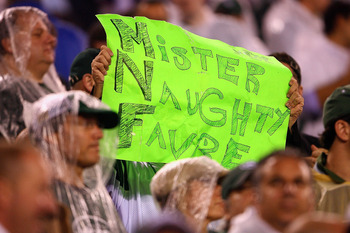 EAST RUTHERFORD, NJ - OCTOBER 11:  A fan holds up a sign which reads 'Mister Naughty Favre' in reference to quarterback Brett Favre #4 of the Minnesota Vikings against the New York Jets at New Meadowlands Stadium on October 11, 2010 in East Rutherford, Ne