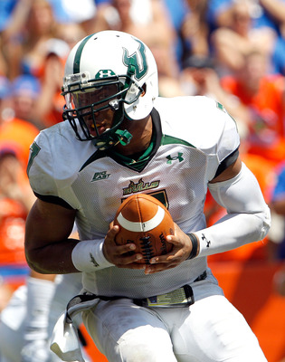 GAINESVILLE, FL - SEPTEMBER 11:  Quarterback B.J. Daniels #7 of the South Florida Bulls attempts a handoff during a game against the Florida Gators at Ben Hill Griffin Stadium on September 11, 2010 in Gainesville, Florida.  (Photo by Sam Greenwood/Getty I