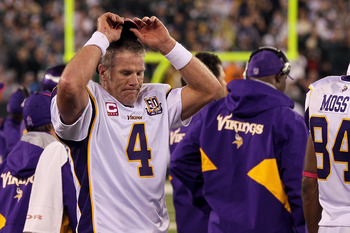 EAST RUTHERFORD, NJ - OCTOBER 11:  Quarterback Brett Favre #4 of the Minnesota Vikings reacts on the sideline in the fourth quarter against the New York Jets at New Meadowlands Stadium on October 11, 2010 in East Rutherford, New Jersey.  (Photo by Jim McI