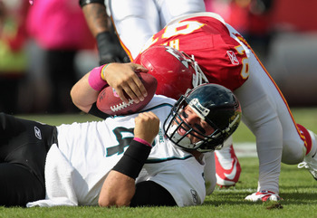 KANSAS CITY, MO - OCTOBER 24:  Quarterback Todd Bauman #4 of the Jacksonville Jaguars is sacked by Tamba Hali #91 of the Kansas City Chiefs during the game on October 24, 2010 at Arrowhead Stadium in Kansas City, Missouri.  (Photo by Jamie Squire/Getty Im