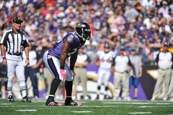 BALTIMORE, MD - OCTOBER 10: Willis McGahee #23 of the Baltimore Ravens prepares to run against the Denver Broncos at M&T Bank Stadium on October 10, 2010 in Baltimore, Maryland. Players wore pink in recognition of Breast Cancer Awareness Month. The Ravens