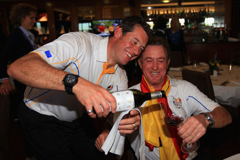 NEWPORT, WALES - OCTOBER 04:  (L-R) Lee Westwood and Miguel Angel Jimenez of Europe celebrate with a glass of wine following Europe's victory in the 2010 Ryder Cup at the Celtic Manor Resort on October 4, 2010 in Newport, Wales.  (Photo by David Cannon/Ge