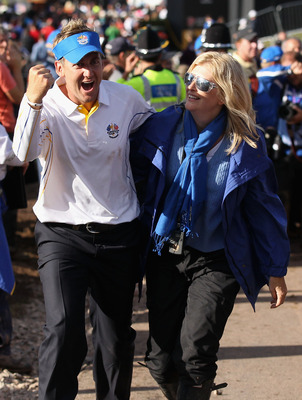 NEWPORT, WALES - OCTOBER 04:  European Team member Ian Poulter (L) walks with his wife Katie Poulter following Europe's 14.5 to 13.5 victory over the USA at the 2010 Ryder Cup at the Celtic Manor Resort on October 4, 2010 in Newport, Wales.  (Photo by Dav