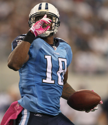 ARLINGTON, TX - OCTOBER 10:  Wide receiver Kenny Britt #18 of the Tennessee Titans celebrates after making a 12 yard touchdown reception in the second quarter against the Dallas Cowboys at Cowboys Stadium on October 10, 2010 in Arlington, Texas. The Titan