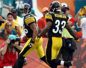 MIAMI - OCTOBER 24:  Receiver Hines Ward #86  celebrates a touchdown against the Miami Dolphins with teammate Isaac Redman #33 at Sun Life Stadium on October 24, 2010 in Miami, Florida.  (Photo by Marc Serota/Getty Images)