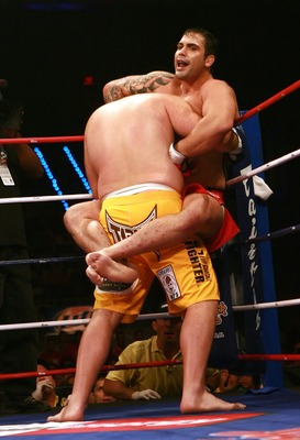HOLLYWOOD, FL - SEPTEMBER 20:  Ricco Rodriguez (red trunks) fights against Ben Rothwell (yellow trunks) during their heavyweight bout during the IFL finals at the Seminole Hard Rock Casino on September 20, 2007 in Hollywood, Florida.  (Photo by Doug Benc/
