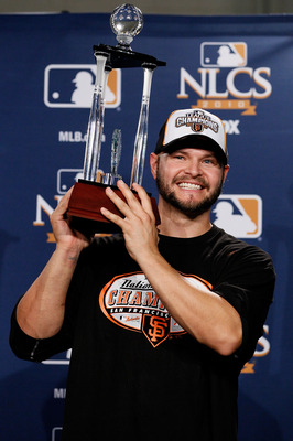 Ross, the 2010 NLCS MVP, lifts his new hardware