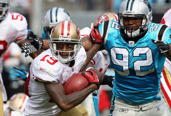 CHARLOTTE, NC - OCTOBER 24:  Ted Ginn #19 of the San Francisco 49ers tries to run away from Eric Norwood #92 of the Carolina Panthers during their game at Bank of America Stadium on October 24, 2010 in Charlotte, North Carolina.  (Photo by Streeter Lecka/