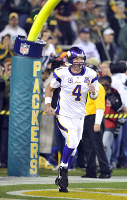 GREEN BAY, WI - OCTOBER 24:  Brett Favre #4 of the Minnesota Vikings runs on the field for pregame warmups against the Green Bay Packers at Lambeau Field on October 24, 2010 in Green Bay, Wisconsin. ( Jim Prisching/ Getty Images)