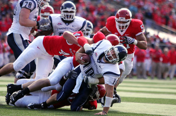 PISCATAWAY, NJ - OCTOBER 18:  Quarterback Zach Frazer #10 of the Connecticut Huskies is stopped just short of the goalline by the defense of the Rutgers Scarlet Knights at Rutgers Stadium on October 18, 2008 in Piscataway, New Jersey.  (Photo by Jim McIsa