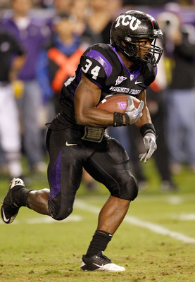 FORT WORTH, TX - OCTOBER 23:  Tailback Ed Wesley #34 of the TCU Horned Frogs carries the ball against the Air Force Falcons at Amon G. Carter Stadium on October 23, 2010 in Fort Worth, Texas.  (Photo by Tom Pennington/Getty Images)