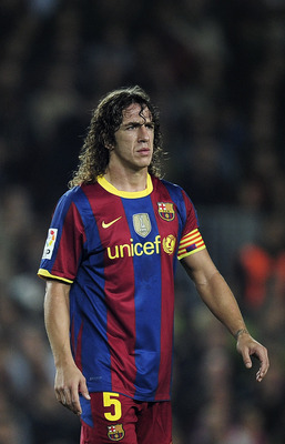 BARCELONA, SPAIN - OCTOBER 16:  Carles Puyol of Barcelona looks on during the La Liga match between Barcelona and Valencia at the Camp Nou stadium on October 16, 2010 in Barcelona, Spain. Barcelona won the match 2-1.  (Photo by David Ramos/Getty Images)