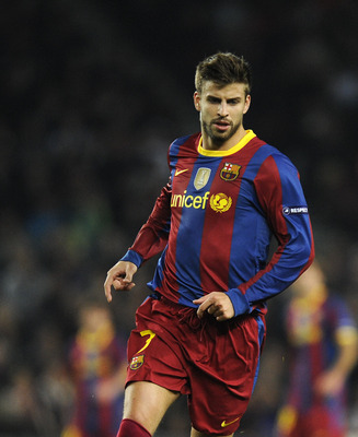 BARCELONA, SPAIN - OCTOBER 20:  Gerard Pique of Barcelona runs with ball during the UEFA Champions League group D match between Barcelona and FC Copenhagen at the Camp nou stadium on October 20, 2010 in Barcelona, Spain. Barcelona won the match 2-0.  (Pho