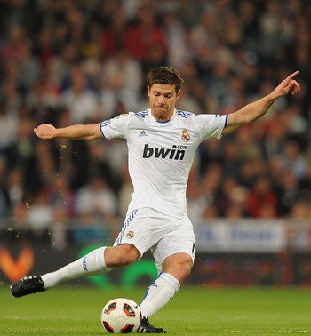 MADRID, SPAIN - OCTOBER 23: Xabi Alonso of Real Madrid in action during the La Liga match between Real Madrid and Racing Santander at Estadio Santiago Bernabeu on October 23, 2010 in Madrid, Spain.  (Photo by Denis Doyle/Getty Images)