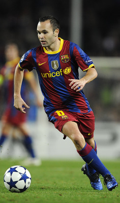 BARCELONA, SPAIN - OCTOBER 20:  Andres Iniesta of Barcelona runs with ball during the UEFA Champions League group D match between Barcelona and FC Copenhagen at the Camp nou stadium on October 20, 2010 in Barcelona, Spain. Barcelona won the match 2-0.  (P