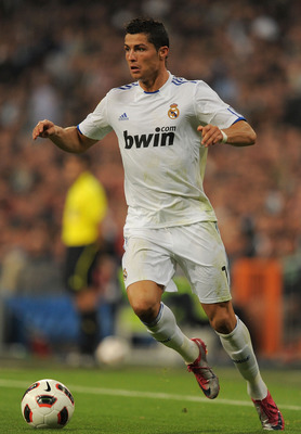 MADRID, SPAIN - OCTOBER 23:  Cristiano Ronaldo of Real Madrid in action during the La Liga match between Real Madrid and Racing Santander at Estadio Santiago Bernabeu on October 23, 2010 in Madrid, Spain.  (Photo by Denis Doyle/Getty Images)