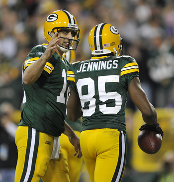GREEN BAY, WI - OCTOBER 24:  Aaron Rodgers #12 of the Green Bay Packers congratulates Greg Jennings #85 after Jennings' touchdown against the Minnesota Vikings  at Lambeau Field on October 24, 2010 in Green Bay, Wisconsin. (Photo by Jim Prisching/Getty Im