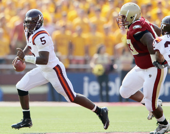 CHESTNUT HILL, MA - SEPTEMBER 25:  Tyrod Taylor #5 of the Virginia Tech Hokies scrambles with the ball as Bryan Murray #93  of the Boston College Eagles defends on September 25, 2010 at Alumni Stadium in Chestnut Hill, Massachusetts.  (Photo by Elsa/Getty