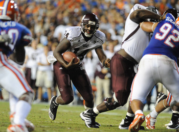GAINESVILLE, FL - OCTOBER 16:  Quarterback Chris Relf #14 of the Mississippi State Bulldogs runs upfield against the Florida Gators  October 16, 2010 Ben Hill Griffin Stadium at Gainesville, Florida.  (Photo by Al Messerschmidt/Getty Images)