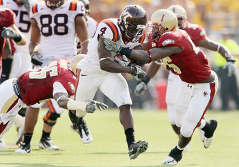 CHESTNUT HILL, MA - SEPTEMBER 25:  David Wilson #4 of the Virginia Tech Hokies carries the ball as Dominick LeGrande #26 and Wes Davis #45 of the Boston College Eagles defend on September 25, 2010 at Alumni Stadium in Chestnut Hill, Massachusetts. Virgini