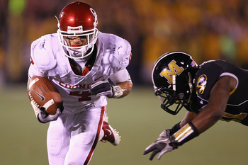 COLUMBIA, MISSOURI - OCTOBER 23: Kenny Stills #4 of the Oklahoma Sooners gets past Jarrell Harrison #11 of the Missouri Tigers at Faurot Field/Memorial Stadium on October 23, 2010 in Columbia, Missouri.  (Photo by Dilip Vishwanat/Getty Images)