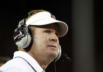 TUCSON, AZ - OCTOBER 23:  Head coach Mike Stoops of the Arizona Wildcats watches from the sidelines during the college football game against the Washington Huskies at Arizona Stadium on October 23, 2010 in Tucson, Arizona.  (Photo by Christian Petersen/Ge