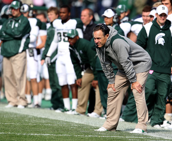 EVANSTON, IL - OCTOBER 23: Head coach Mark Dantonio of the Michigan State Spartans (R) returned to the sidelines for a game against the Northwestern Wildcats at Ryan Field on October 23, 2010 in Evanston, Illinois. Michigan State defeated Northwestern 35-