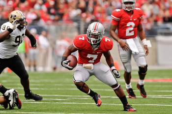 COLUMBUS, OH - OCTOBER 23:  Jordan Hall #7 of the Ohio State Buckeyes runs with the ball against the Purdue Boilermakers at Ohio Stadium on October 23, 2010 in Columbus, Ohio.  (Photo by Jamie Sabau/Getty Images)