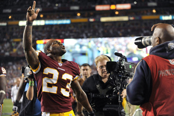 LANDOVER, MD - SEPTEMBER 12:  DeAngelo Hall #23 of the Washington Redskins celebrates his touchdown during the NFL season opener against the Dallas Cowboys at FedExField on September 12, 2010 in Landover, Maryland. The Redskins lead the Cowboys 10-3 at ha
