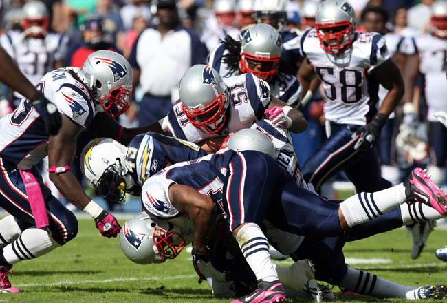 SAN DIEGO - OCTOBER 24:  Runningback Darren Sproles #43 of the San Diego Chargers is tackled by the New England Patriots Defense during NFL game on October 24, 2010 at Qualcomm Stadium in San Diego, California. (Photo by Donald Miralle/Getty Images)