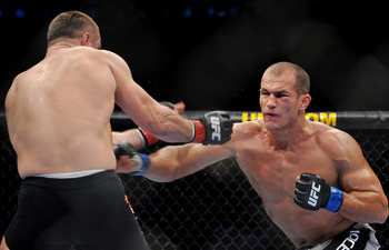 DALLAS - SEPTEMBER 19:  UFC fighter Junior Dos Santos (R) battles UFC fighter Mirko Cro Cop (L) during their Heavyweight bout at UFC 103: Franklin vs. Belfort at the American Airlines Center on September 19, 2009 in Dallas, Texas.  (Photo by Jon Kopaloff/