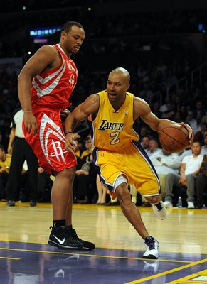 LOS ANGELES, CA - JANUARY 05:  Derek Fisher #2 of the Los Angeles Lakers dribbles around Chuck Hayes #44 of the Houston Rockets during the game at Staples Center on January 5, 2010 in Los Angeles, California.  NOTE TO USER: User expressly acknowledges and