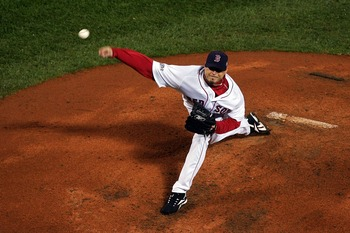 BOSTON - OCTOBER 24:  Starting pitcher Josh Beckett #19 of the Boston Red Sox winds up against the Colorado Rockies during Game One of the 2007 Major League Baseball World Series at Fenway Park on October 24, 2007 in Boston, Massachusetts.  (Photo by Jim