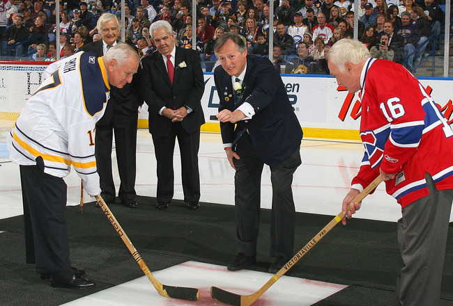 BUFFALO, NY - OCTOBER 15: Former Buffalo Sabres owner Seymour Knox III re-enacts the first puck drop at the first home game for the Buffalo Sabres 40 years ago on this date against  the Montreal Canadiens  against at HSBC Arena on October 15, 2010 in Buff