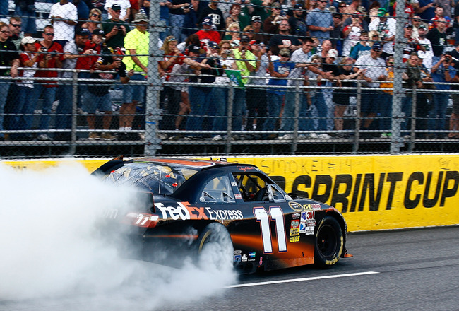 MARTINSVILLE, VA - OCTOBER 24:  Denny Hamlin, driver of the #11 FedEx Express Toyota, burnsout after winning the NASCAR Sprint Cup Series TUMS Fast Relief 500 at Martinsville Speedway on October 24, 2010 in Martinsville, Virginia.  (Photo by Jason Smith/G