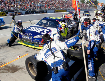MARTINSVILLE, VA - OCTOBER 24: Jimmie Johnson, driver of the #48 Lowe's Chevrolet, pits during the NASCAR Sprint Cup Series TUMS Fast Relief 500 at Martinsville Speedway on October 24, 2010 in Martinsville, Virginia.  (Photo by Geoff Burke/Getty Images fo