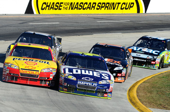 MARTINSVILLE, VA - OCTOBER 24:  Kevin Harvick, driver of the #29 Shell/Pennzoil Chevrolet, races Jimmie Johnson, driver of the #48 Lowe's Chevrolet, during the NASCAR Sprint Cup Series TUMS Fast Relief 500 at Martinsville Speedway on October 24, 2010 in M